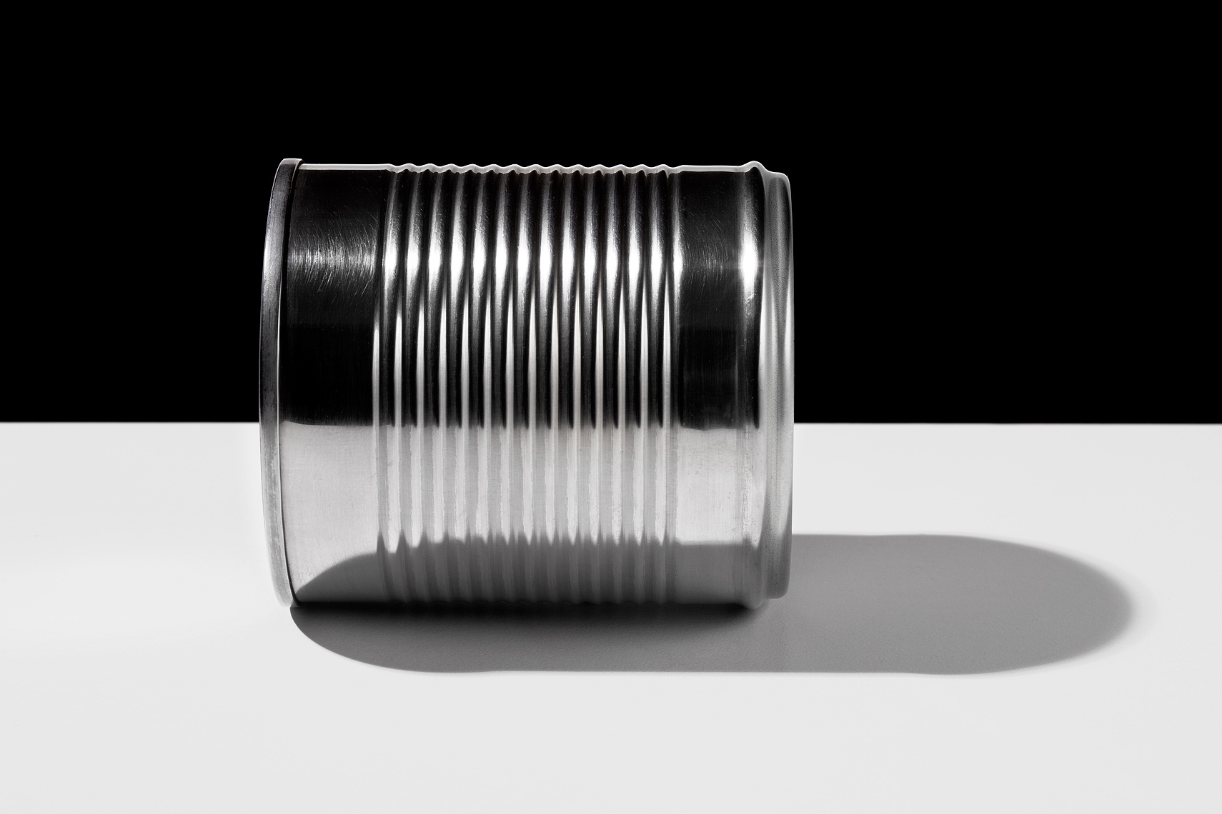 Aluminum can on table side view by John Kuczala