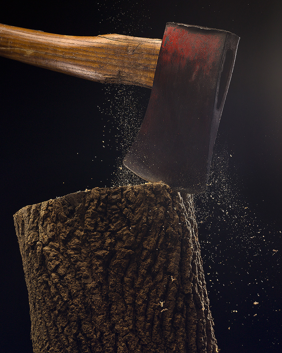 Axe chopping log stop-action photo by John Kuczala