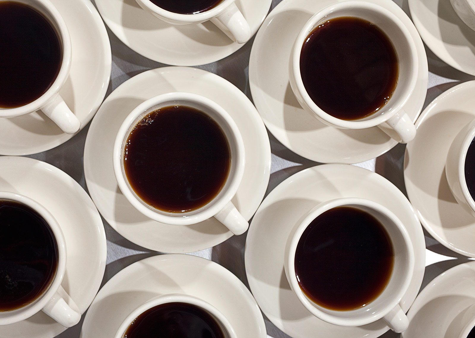 Coffee cups in a row food photography by John Kuczala