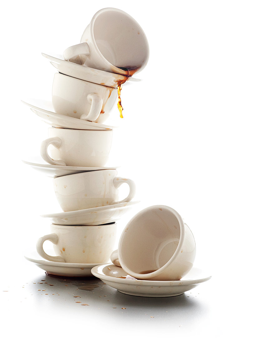 Coffee cups used and stacked food photography by John Kuczala
