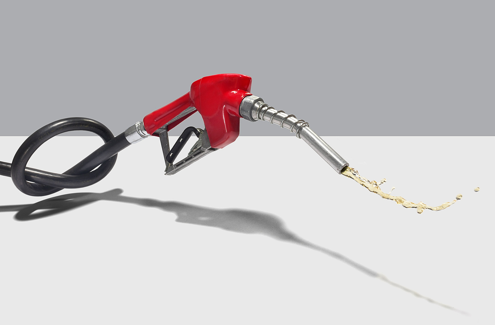 Knotted gas pump hose conceptual photo by John Kuczala