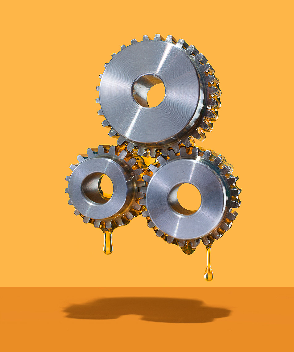 Oiled gears teamwork conceptual photo by John Kuczala