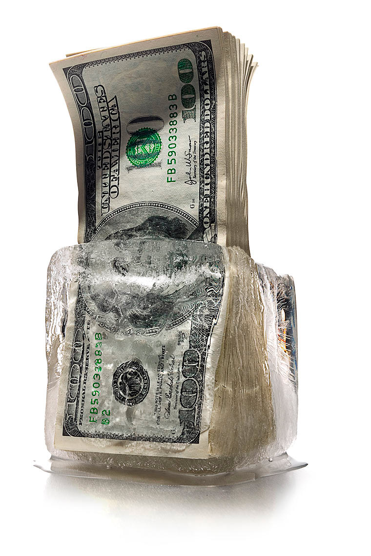 Cash freeze melting hundred dollar bills photo by John Kuczala