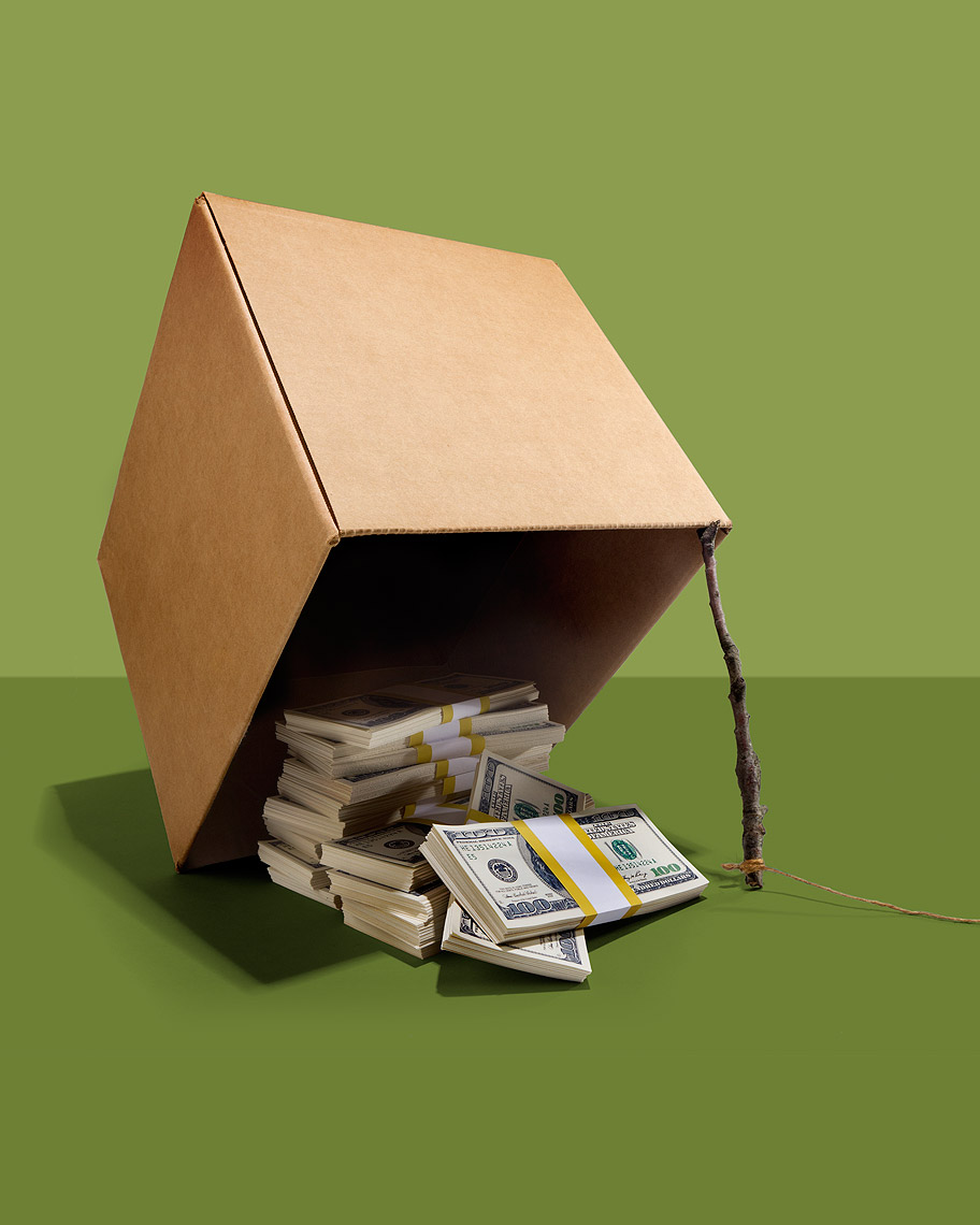Cardboard box money trap, with cash bait photo by John Kuczala