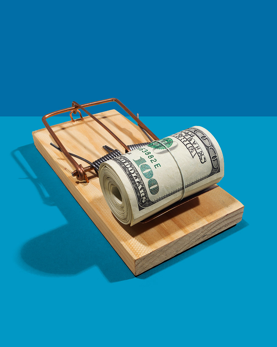 Mouse trap baited with cash photo-Illustration by John Kuczala